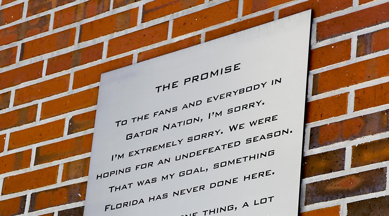 In this Saturday, Sept. 26, 2015 photo, The promise made by Tim Tebow is seen on a plaque at Ben Hill Griffin Stadium before an NCAA college football game between Florida and Tennessee in Gainesville, Fla. It's been seven years since Tim Tebow delivered a