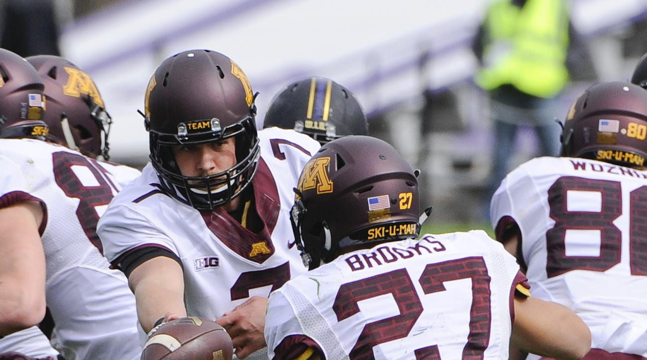 Minnesota quarterback Mitch Leidner (7) hands off to Minnesota running back Shannon Brooks (27) during the first half of an NCAA college football game against Northwestern in Evanston, Ill.,  Saturday, Oct. 3, 2015. (AP Photo/Matt Marton)