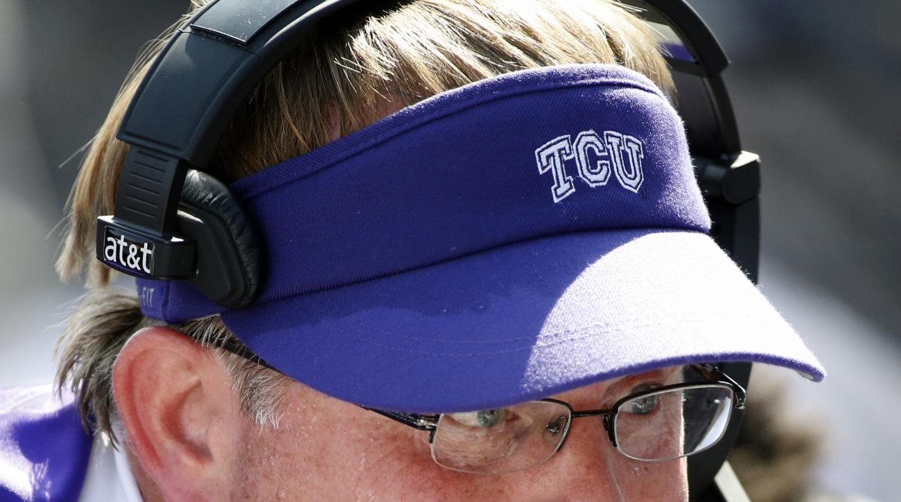 TCU head coach Gary Patterson talks with players in the second quarter of an NCAA college football game against Texas, Saturday, Oct. 3, 2015, in Fort Worth, Texas. (AP Photo/Ron Jenkins)