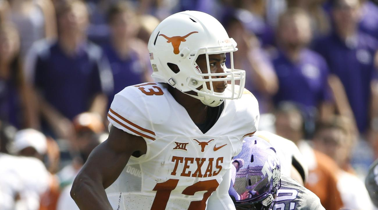 Texas quarterback Jerrod Heard (13) is pursued by TCU linebacker Montrel Wilson (20) in the first half of an NCAA football game Saturday, Oct. 3, 2015, in Fort Worth, Texas. (AP Photo/Ron Jenkins)