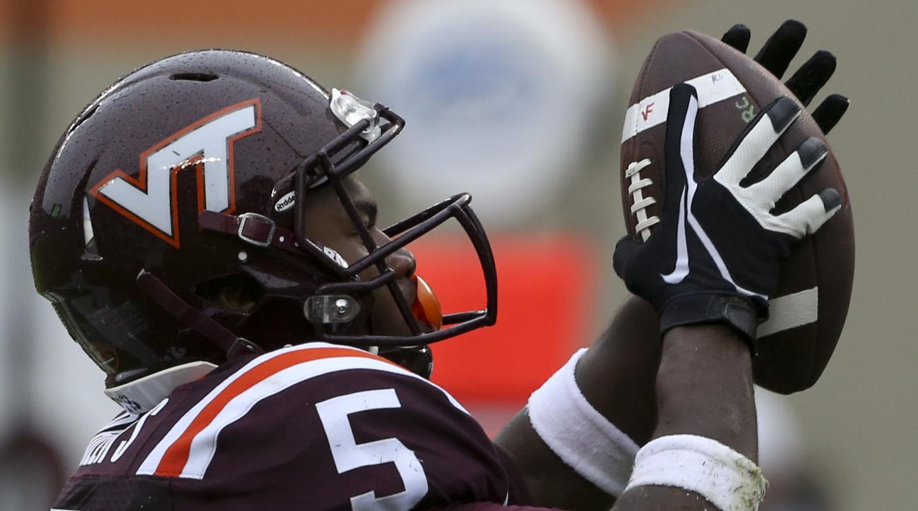 Virginia Tech reciver Cam Phillips (5) catches a touchdown pass against Pittsburgh during the first half of an NCAA college football game, Saturday, Oct. 3 2015,  in Blacksburg Va. (Matt Gentry/The Roanoke Times via AP)