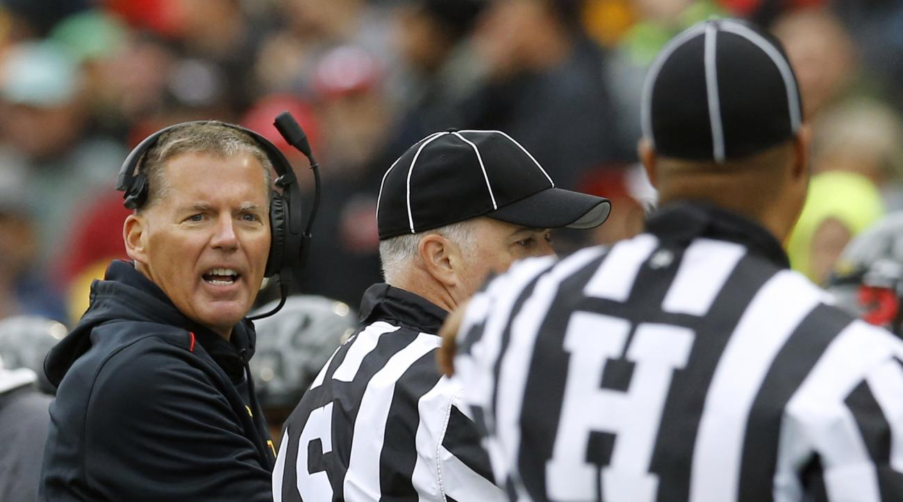 Maryland head coach Randy Edsall, left, pleads with officials in the first half of an NCAA college football game against Michigan, Saturday, Oct. 3, 2015, in College Park, Md. (AP Photo/Patrick Semansky)
