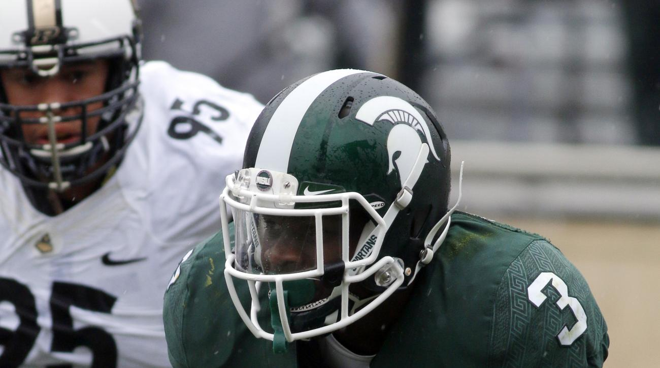 Michigan State's L.J. Scott (3) rushes against Purdue's Evan Panfil during the second quarter of an NCAA college football game, Saturday, Oct. 3, 2015, in East Lansing, Mich. (AP Photo/Al Goldis)