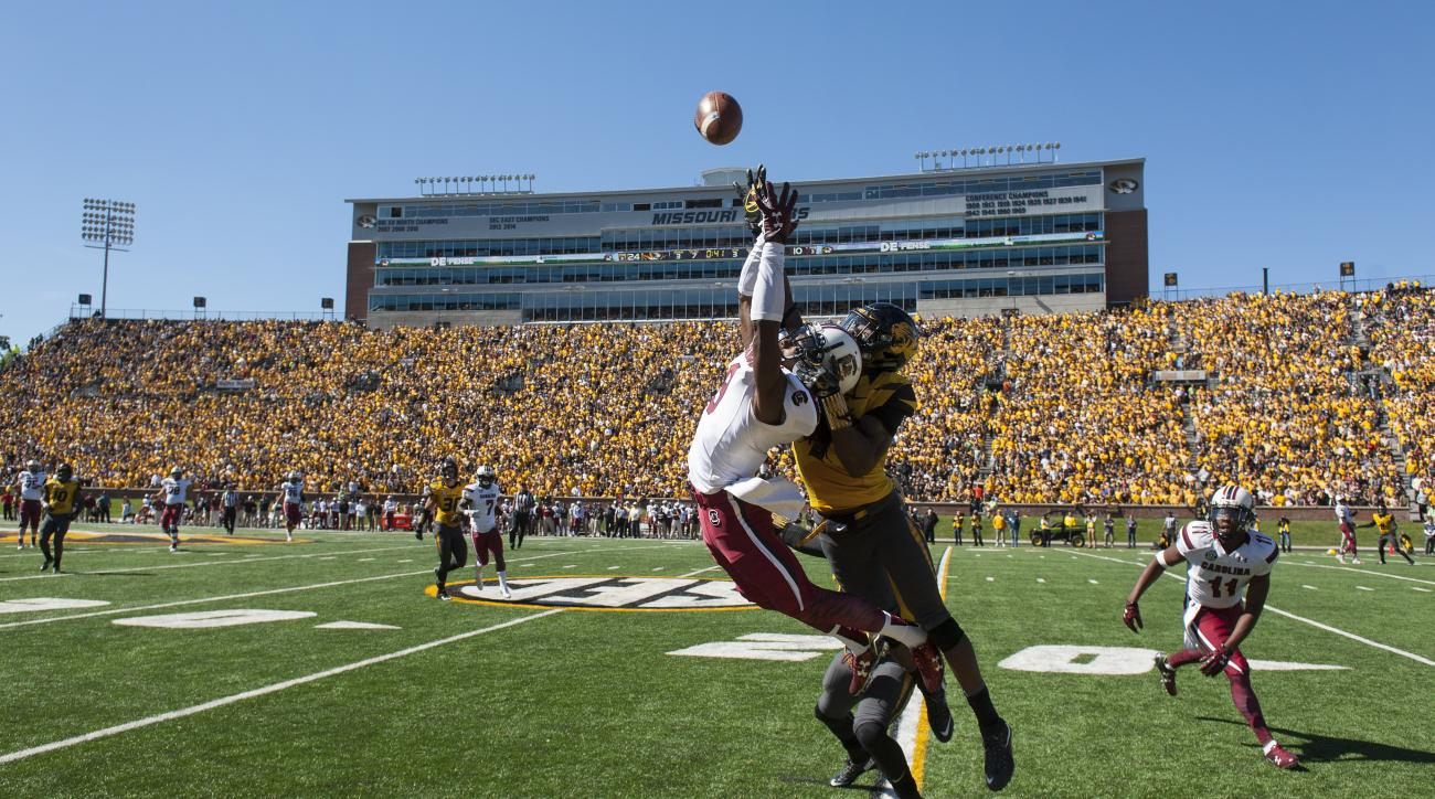 Missouri defensive back Kenya Dennis, right, breaks up a pass intended for South Carolina wide receiver Jerad Washington, left, during the third quarter of an NCAA college football game, Saturday, Oct. 3, 2015, in Columbia, Mo. (AP Photo/L.G. Patterson)