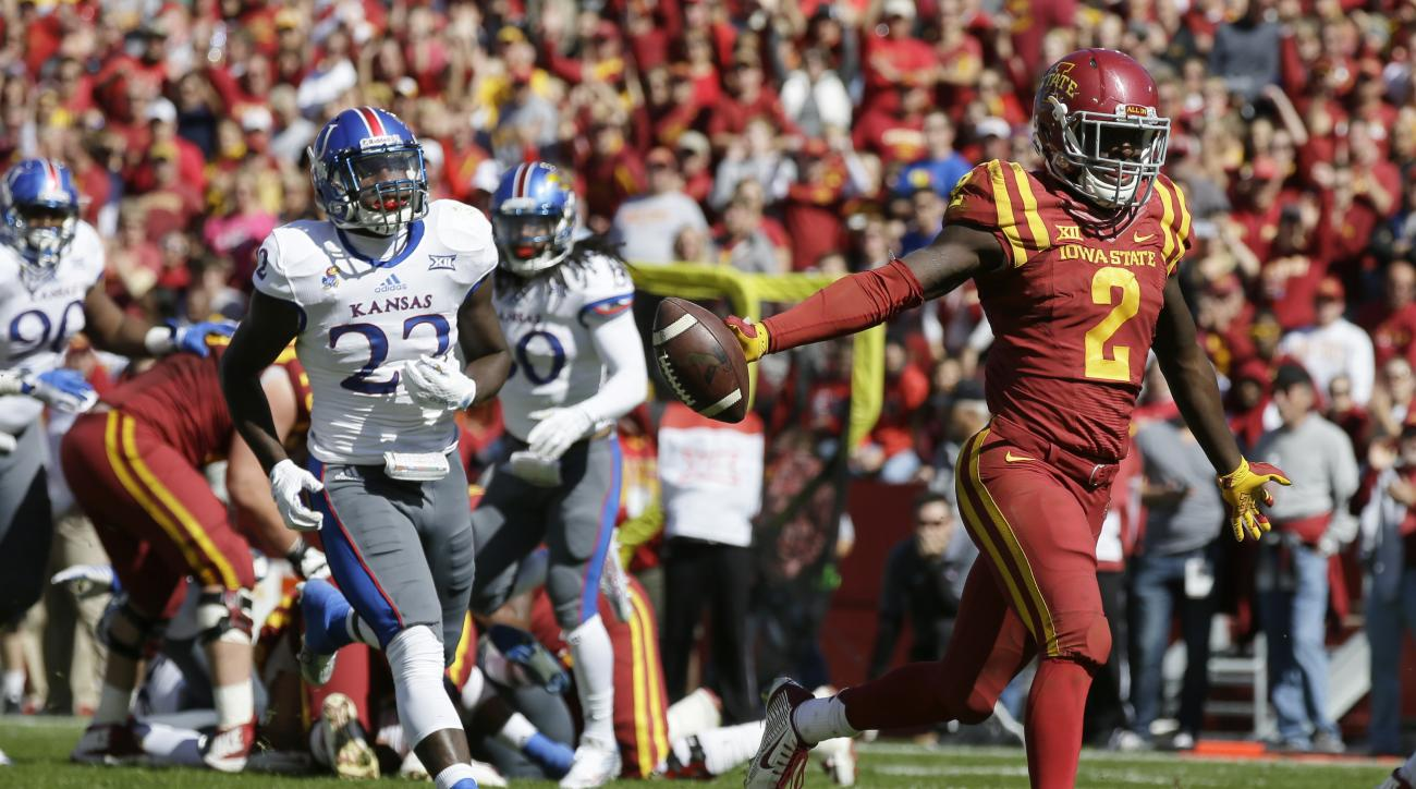 Iowa State running back Mike Warren (2) runs from Kansas safety Greg Allen (22) for a 7-yard touchdown run in the second half of an NCAA college football game, Saturday, Oct. 3, 2015, in Ames, Iowa. Iowa State won 38-13. (AP Photo/Charlie Neibergall)