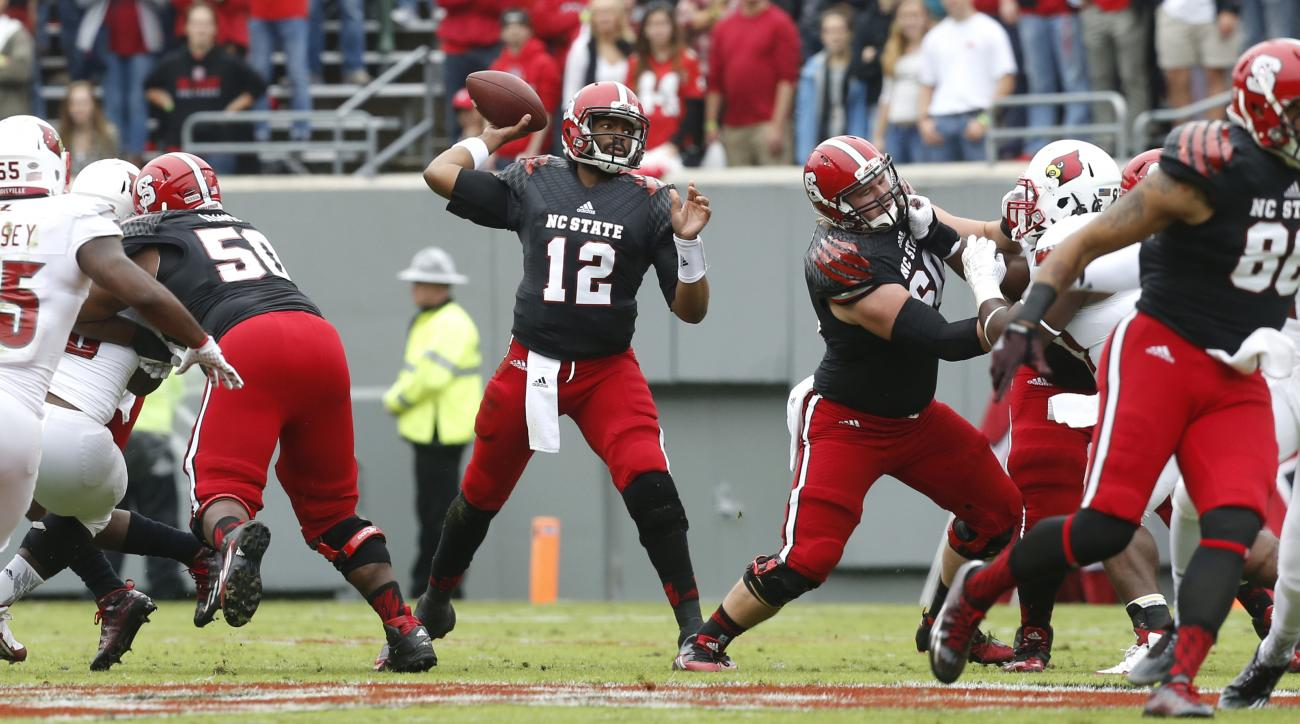 North Carolina State quarterback Jacoby Brissett (12) passes during the first half  of an NCAA college football game against Louisville at Carter-Finley Stadium in Raleigh, N.C., Saturday, Oct. 3, 2015. (Ethan Hyman/The News & Observer via AP) MANDATORY C