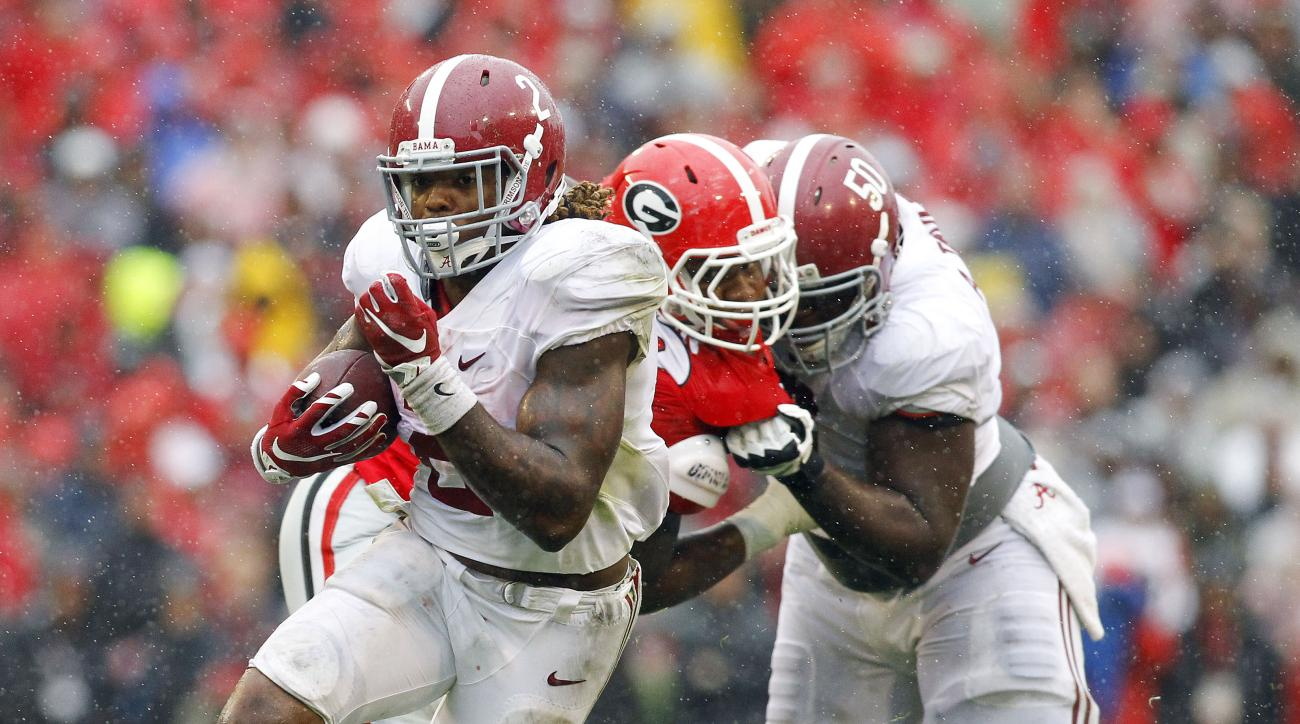 Alabama running back Derrick Henry (2) runs for a touchdown as offensive lineman Alphonse Taylor (50) blocks Georgia defensive tackle Trenton Thompson (78) in the first half of an NCAA college football game, Saturday, Oct. 3, 2015, in Athens, Ga. (AP Phot