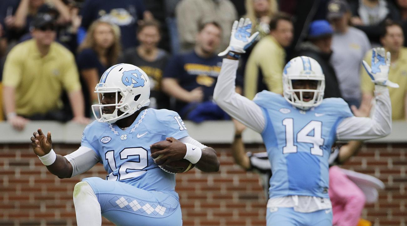 North Carolina quarterback Marquise Williams, left, scores a touchdown in the second quarter of an NCAA college football game against Georgia Tech Saturday, Oct. 3, 2015, in Atlanta. (AP Photo/David Goldman)