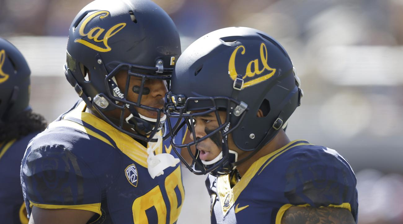California's Bryce Treggs, right, celebrates with Stephen Anderson after scoring a touchdown against Washington State during the first half of an NCAA college football game Saturday, Oct. 3, 2015, in Berkeley, Calif. (AP Photo/Ben Margot)