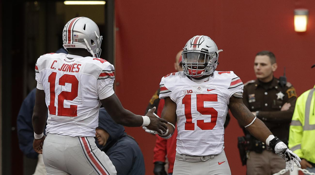 Ohio State's Ezekiel Elliott (15) celebrates with Cardale Jones (12) after Elliott ran 55 yards for a touchdown during the second half of an NCAA college football game  against Indiana, Saturday, Oct. 3, 2015 in Bloomington, Ind. (AP Photo/Darron Cummings