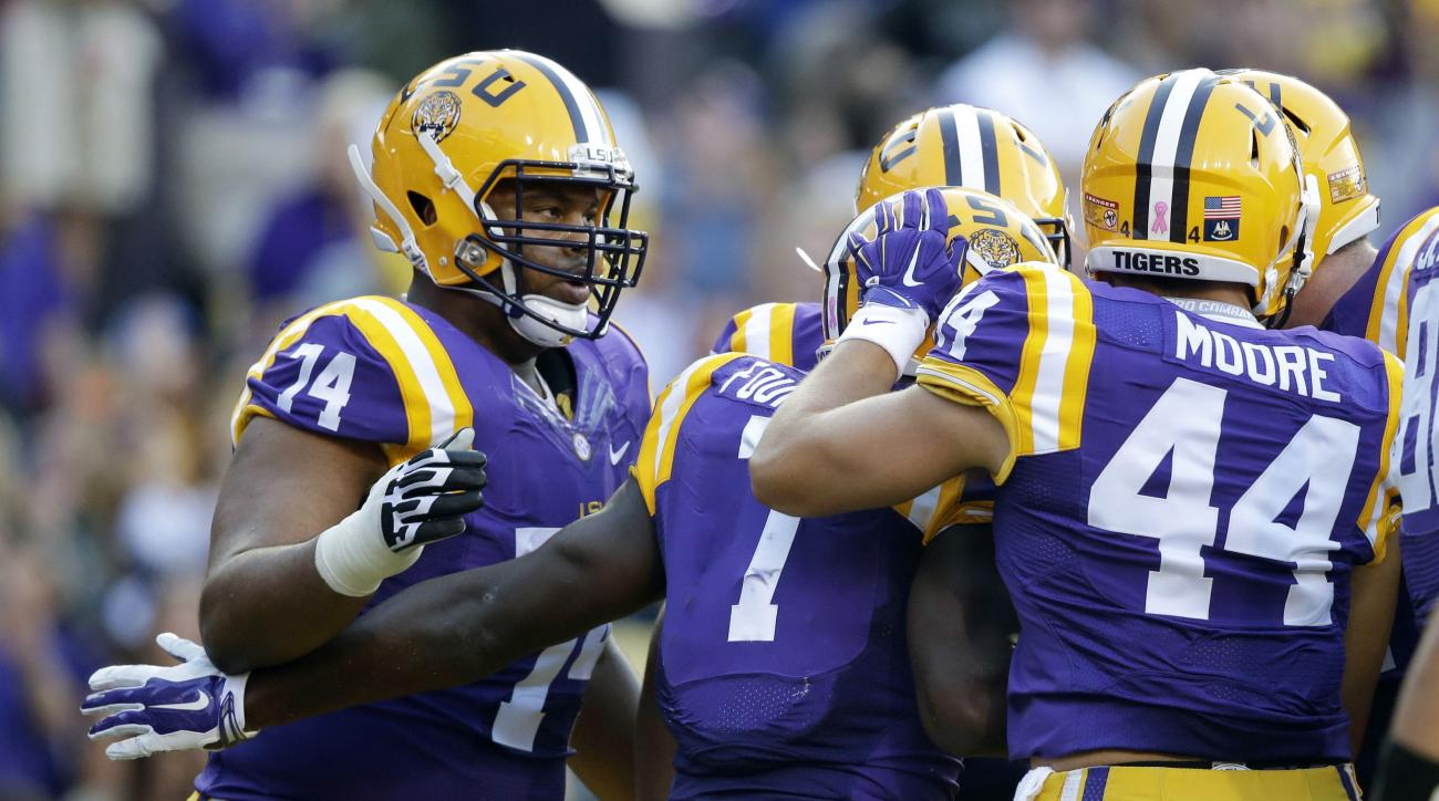 LSU running back Leonard Fournette (7) is congratulated on his touchdown carry in the first half of an NCAA college football game against Eastern Michigan in Baton Rouge, La., Saturday, Oct. 3, 2015. (AP Photo/Gerald Herbert)