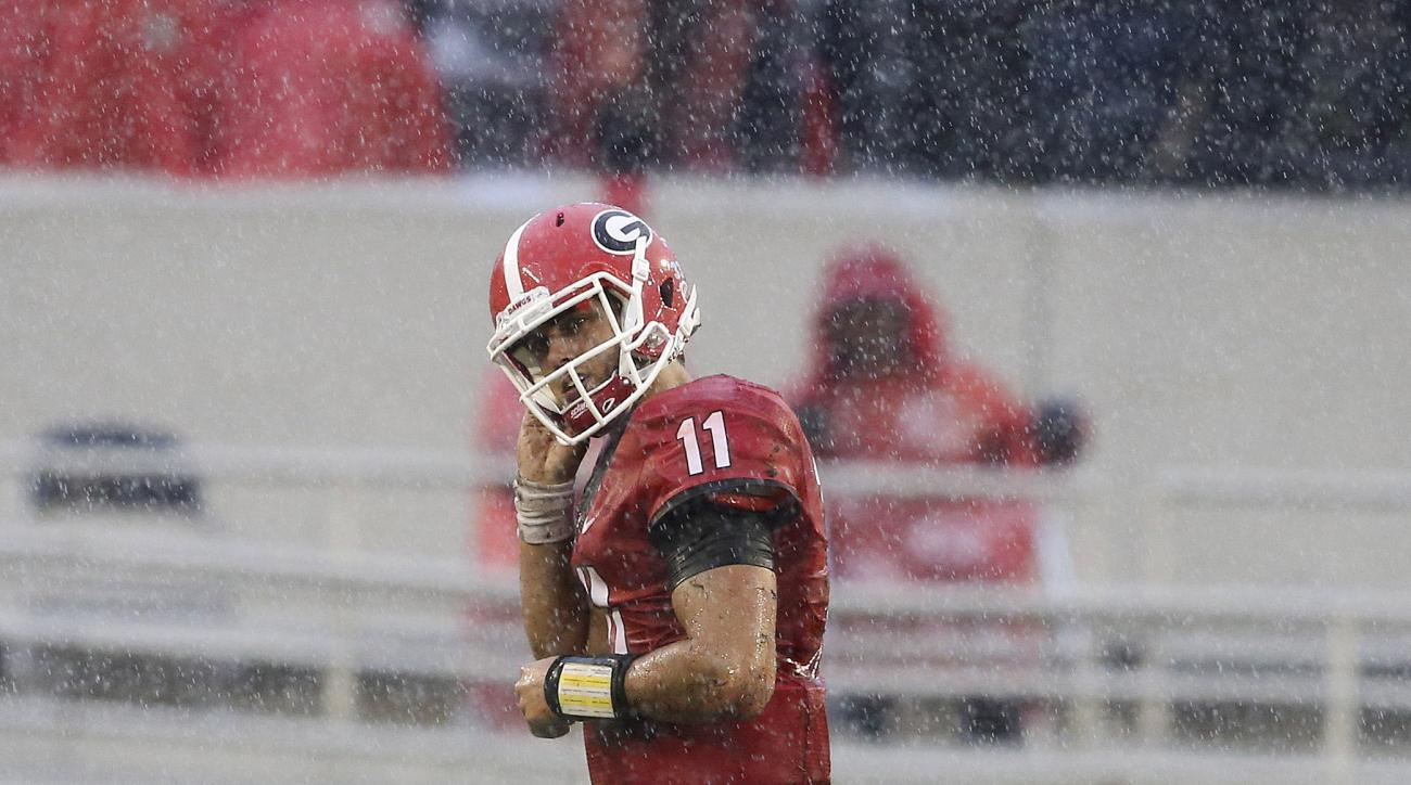 Georgia quarterback Greyson Lambert (11) trots off the field after a fumble in the second half of an NCAA college football game against the Alabama, Saturday, Oct. 3, 2015, in Athens, Ga. Alabama won 38-10. (AP Photo/John Bazemore)