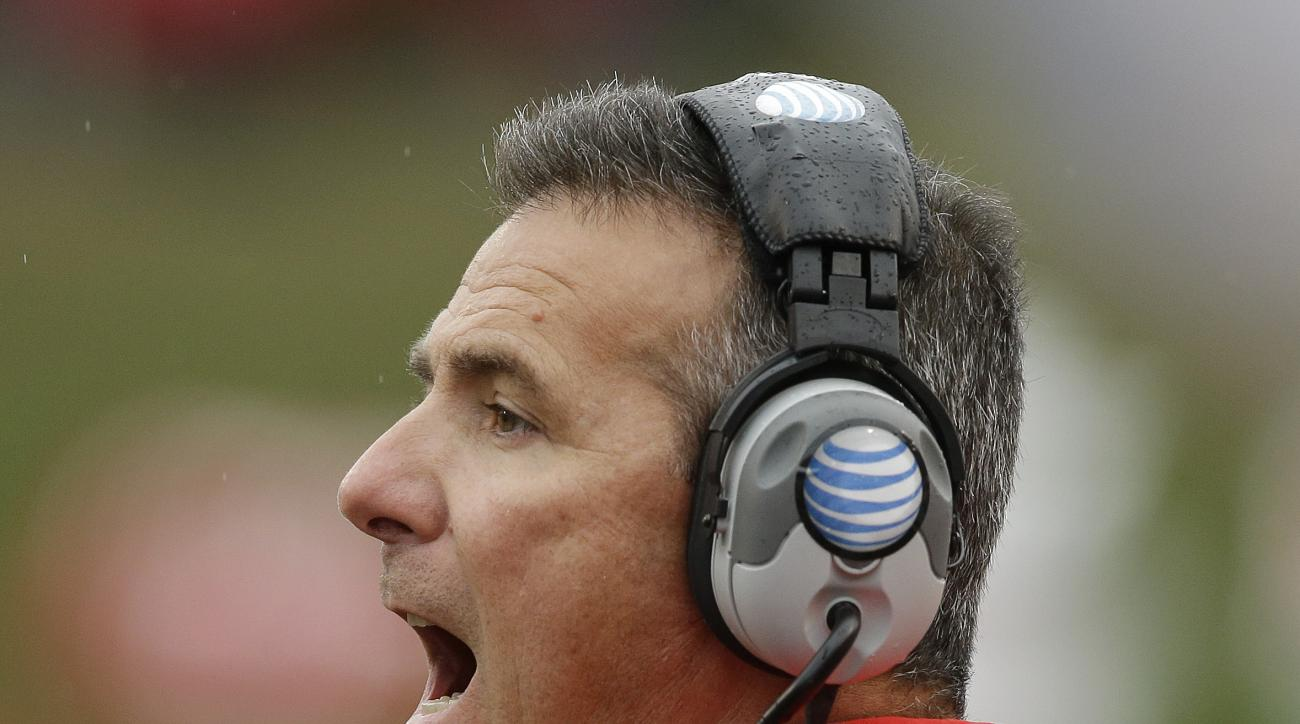 Ohio State head coach Urban Meyer shouts instructions during the second half of an NCAA college football game against Indiana, Saturday, Oct. 3, 2015 in Bloomington, Ind. Ohio State won 34-27. (AP Photo/Darron Cummings)