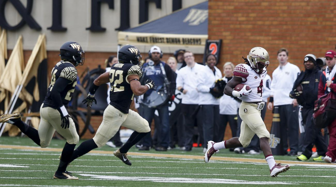 Florida State running back Dalvin Cook (4) limps to the sideline after he was injured during a run against Wake Forest in the first half of an NCAA college football game in Winston-Salem, N.C., Saturday, Oct. 3, 2015. Florida State won 24-16. (AP Photo/Ne