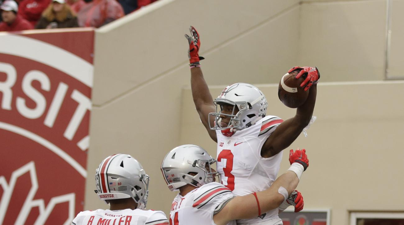 Ohio State's Michael Thomas (3) celebrates with Nick Vannett (81) and Braxton Miller (1) after Thomas caught a 23-yard touchdown pass during the second half of an NCAA college football game against Indiana, Saturday, Oct. 3, 2015 in Bloomington, Ind. Ohio