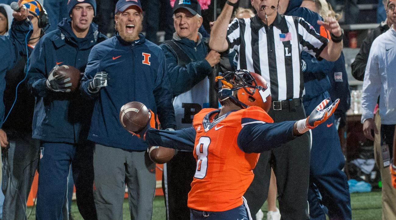Illinois wide receiver Geronimo Allison (8) celebrates his touchdown in the closing seconds of the fourth quarter to tie the game against Nebraska during an NCAA college football game Saturday, Oct. 3, 2015, at Memorial Stadium in Champaign, Ill.  Illinoi