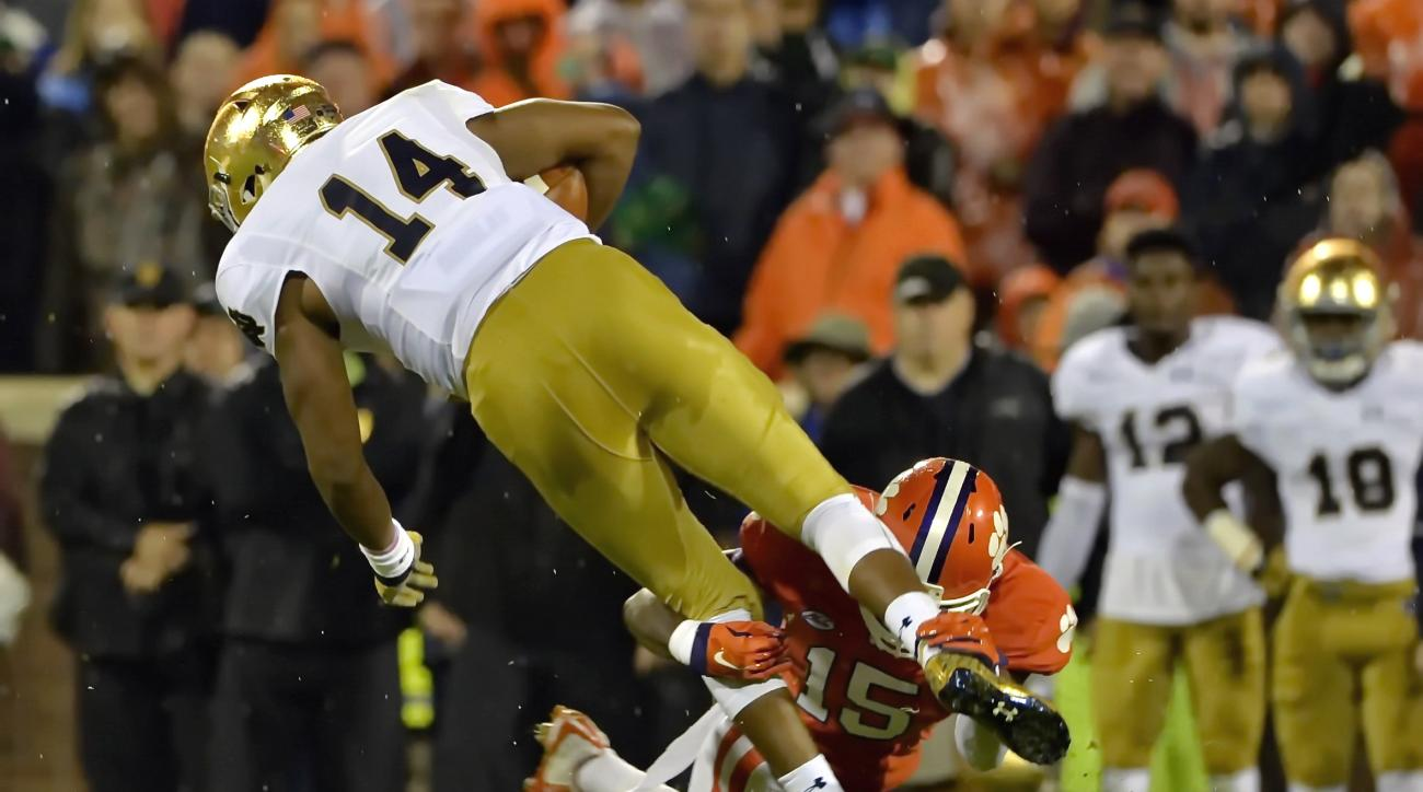 Notre Dame quarterback DeShone Kizer (14) is tackled by Clemson's T.J. Green during the first half of an NCAA college football game Saturday, Oct. 3, 2015, in Clemson, S.C. (AP Photo/Richard Shiro)