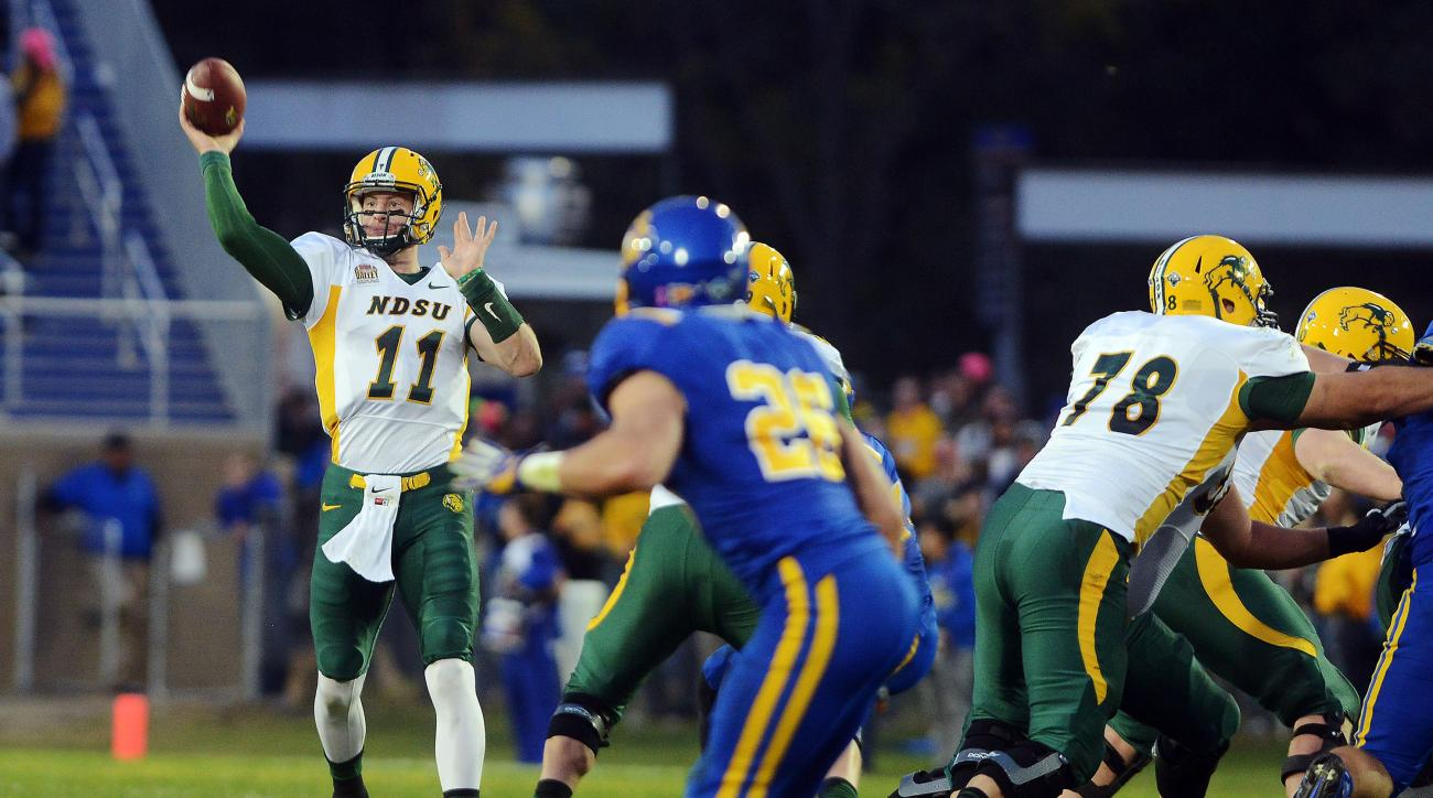 North Dakota State's Carson Wentz throws during an NCAA college football game against South Dakota State, Saturday, Oct. 3, 2015, in Brookings, S.D. (Elisha Page/The Argus Leader via AP) NO SALES; MANDATORY CREDIT
