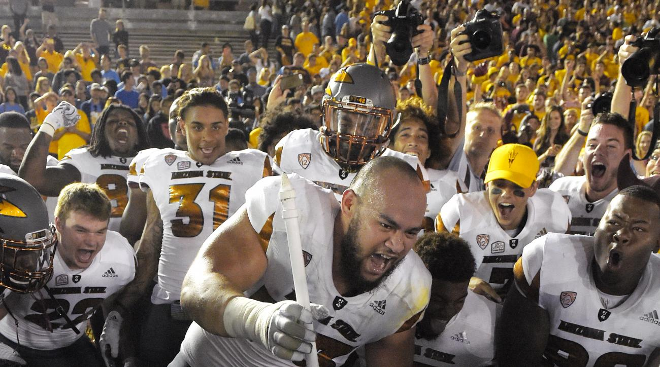 Arizona State offensive lineman Vi Teofilo jams mascot Sparky's pitchfork into the ground after Arizona State defeated UCLA in an NCAA college football game, Saturday, Oct. 3, 2015, in Pasadena, Calif. Arizona State won 38-23. (AP Photo/Mark J. Terrill)