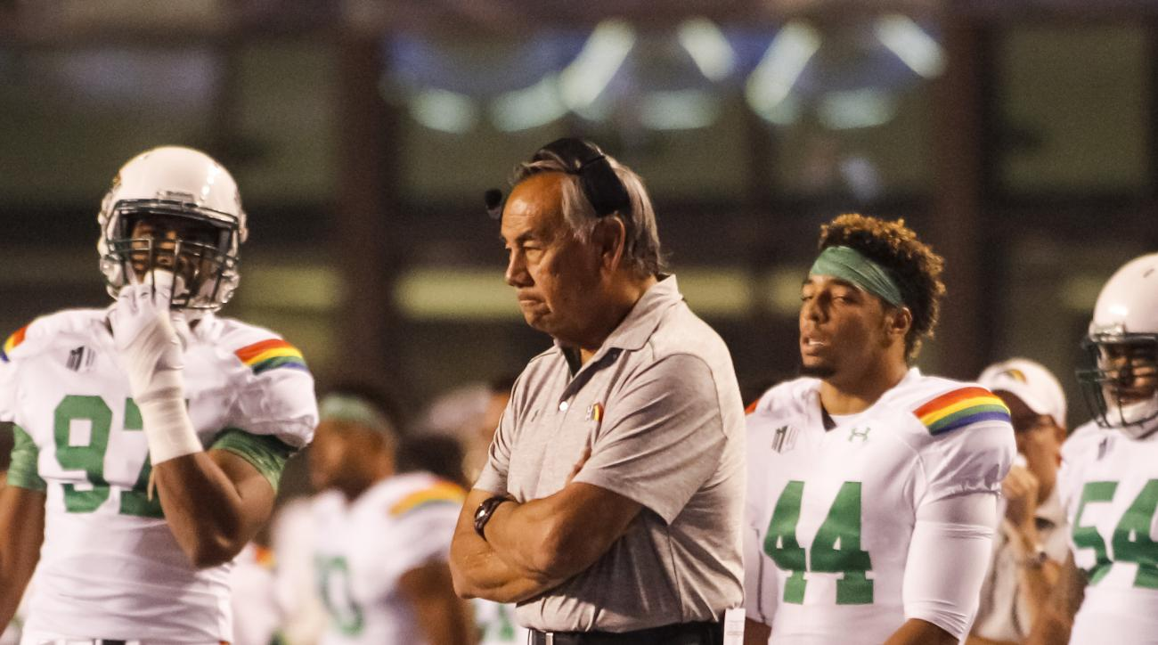 Hawaii head coach Norm Chow watches the action during the first half of an NCAA college football game against Boise State in Boise, Idaho, on Saturday, Oct. 3, 2015. (AP Photo/Otto Kitsinger)