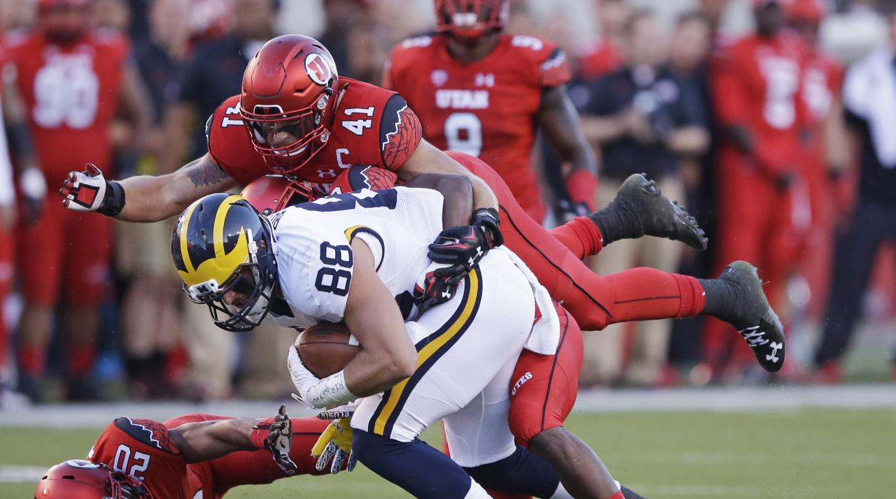 FILE - In this Sept. 3, 2015, file photo, Utah linebacker Jared Norris (41) tackles Michigan tight end Jake Butt (88) during an NCAA college football game in Salt Lake City. The Utah football team is ranked No. 5 for just the third time in school history.