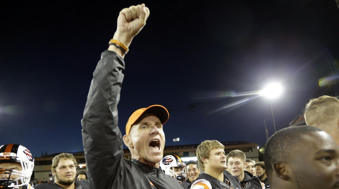 FILE - In this Sept. 4, 2015, file photo, Oregon State football coach Gary Anderson celebrates a 26-7 win over Weber State after an NCAA college football game in Corvallis, Ore. On his first bye week as Oregon State's coach, Anderson took some time last w