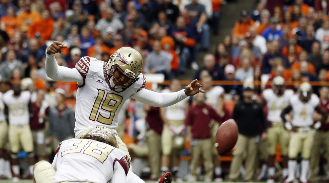 FILE - In this Oct. 11, 2014, file photo, Florida State place kicker Roberto Aguayo (19) kicks a field goal against Syracuse off the hold from Cason Beatty (38) during the first half of an NCAA college football game in Syracuse, N.Y. Growing up in Mascott