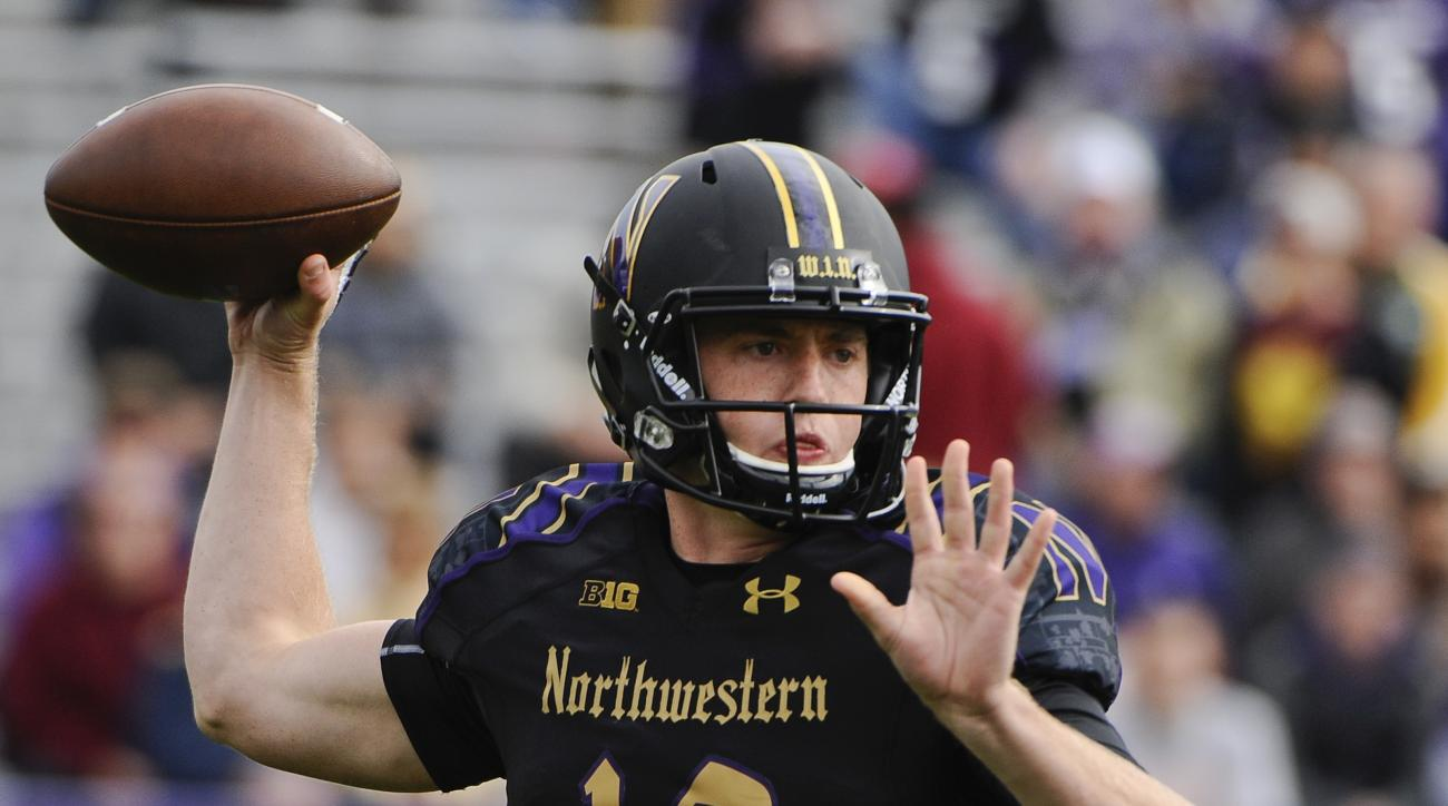FILE - In this Oct. 3, 2015, file photo, Northwestern quarterback Clayton Thorson (18) looks to pass against Minnesota during the first half of an NCAA college football game in Evanston, Ill. No. 13 Northwestern at No. 18 Michigan matches the nation's top