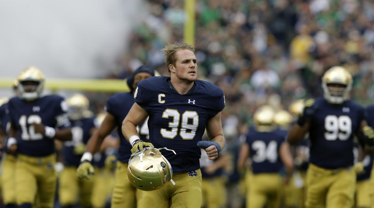 "FILE - In this Sept. 19, 2015, file photo, Notre Dame linebacker Joe Schmidt (38) run out onto the field before an NCAA college football game against Georgia Tech in South Bend, Ind. he words ""former walk-on"" are no longer frequently used to describe Notr"