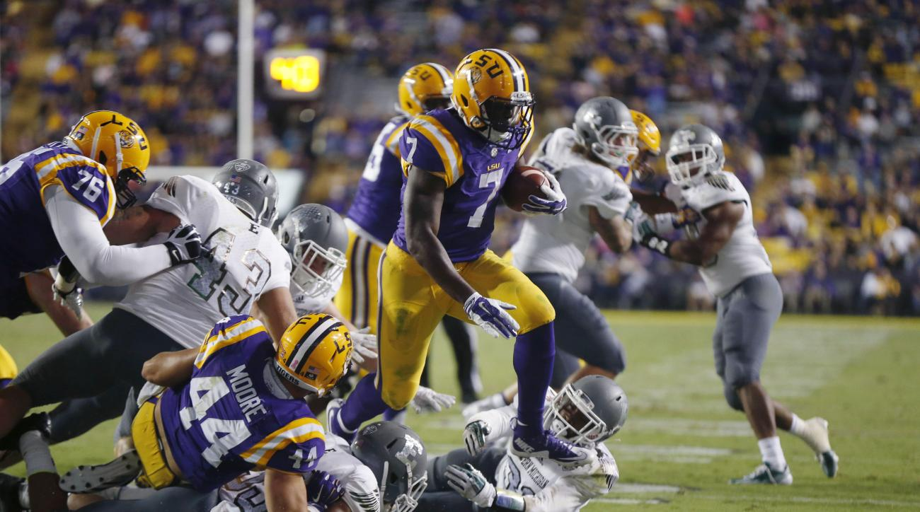 In this Saturday, Oct. 3, 2015, photo, LSU running back Leonard Fournette (7) carries for a touchdown as guard Josh Boutte (76), fullback John David Moore (44) and guard Maea Teuhema, background, block in the second half of an NCAA college football game a