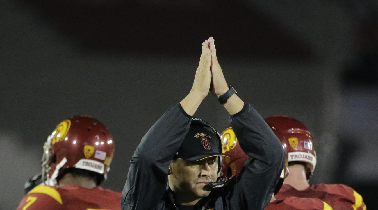 Southern California head coach Steve Sarkisian reacts to a play during the first half of an NCAA college football game against Washington, Thursday, Oct. 8, 2015, in Los Angeles. (AP Photo/Jae C. Hong)