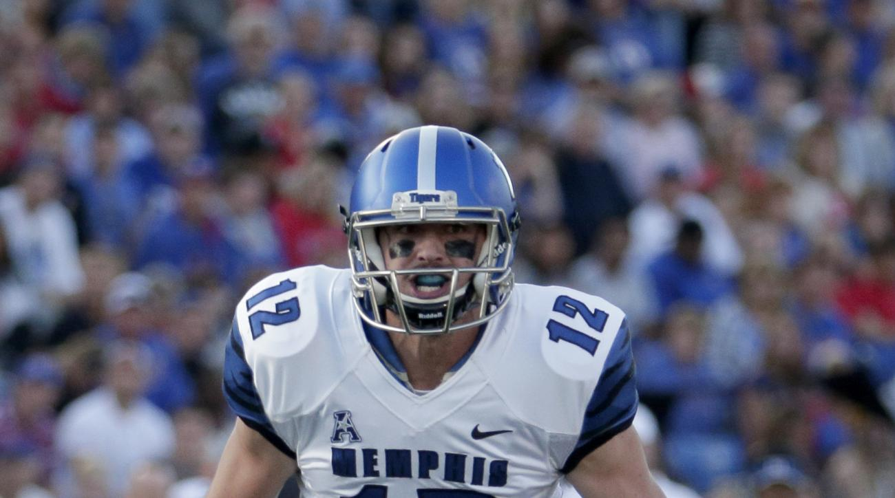 CORRECTS THAT MEMPHIS HAS THE THIRD LONGEST CONSECUTIVE STREAK BEHIND OHIO STATE AND TCU -  FILE - In this Sept. 12, 2015, file photo, Memphis quarterback Paxton Lynch (12) scrambles during an NCAA college football game against Kansas in Lawrence, Kan.  M