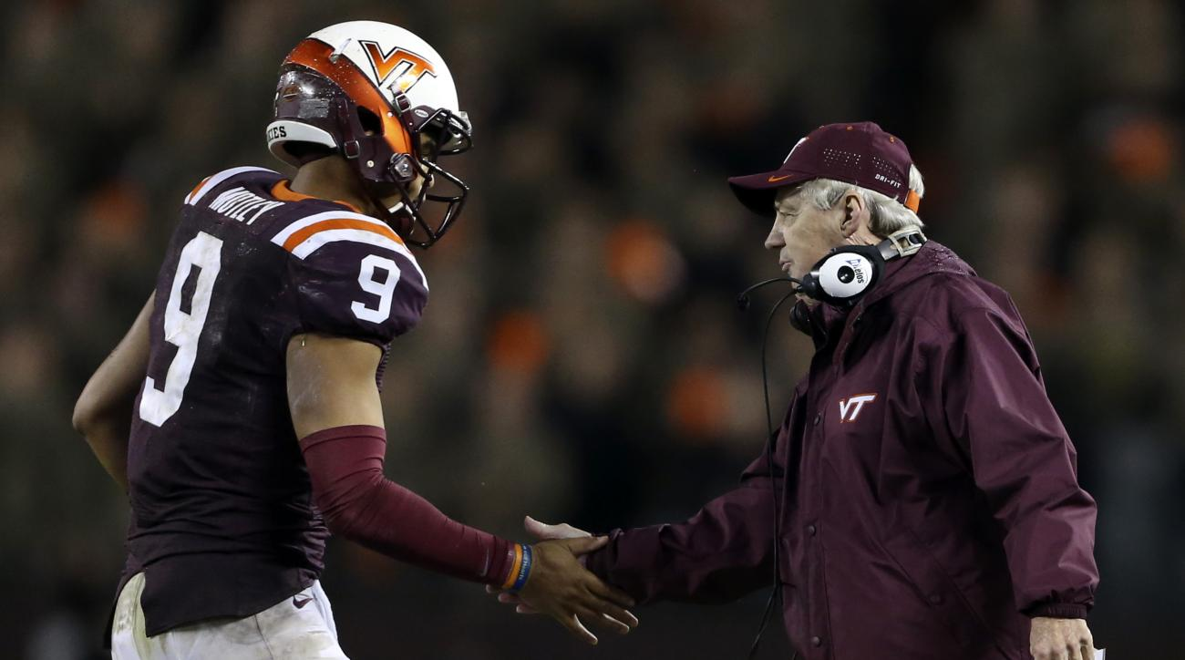 Virginia Tech quarterback Brenden Motley (9) is congratulated by head coach Frank Beamer after his second touchdown pass against North Carolina State during the first half of an NCAA college football game, Friday, Oct. 9, 2015, in Blacksburg, Va. (Matt Ge