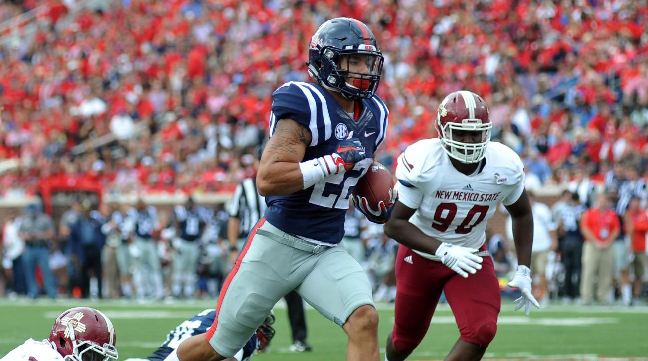 Mississippi running back Jordan Wilkins (22) runs 11-yards for a touchdown against New Mexico State during the first half of an NCAA college football game at Vaught-Hemingway Stadium in Oxford, Miss. on Saturday, Oct. 10, 2015. (Bruce Newman/The Oxford Ea