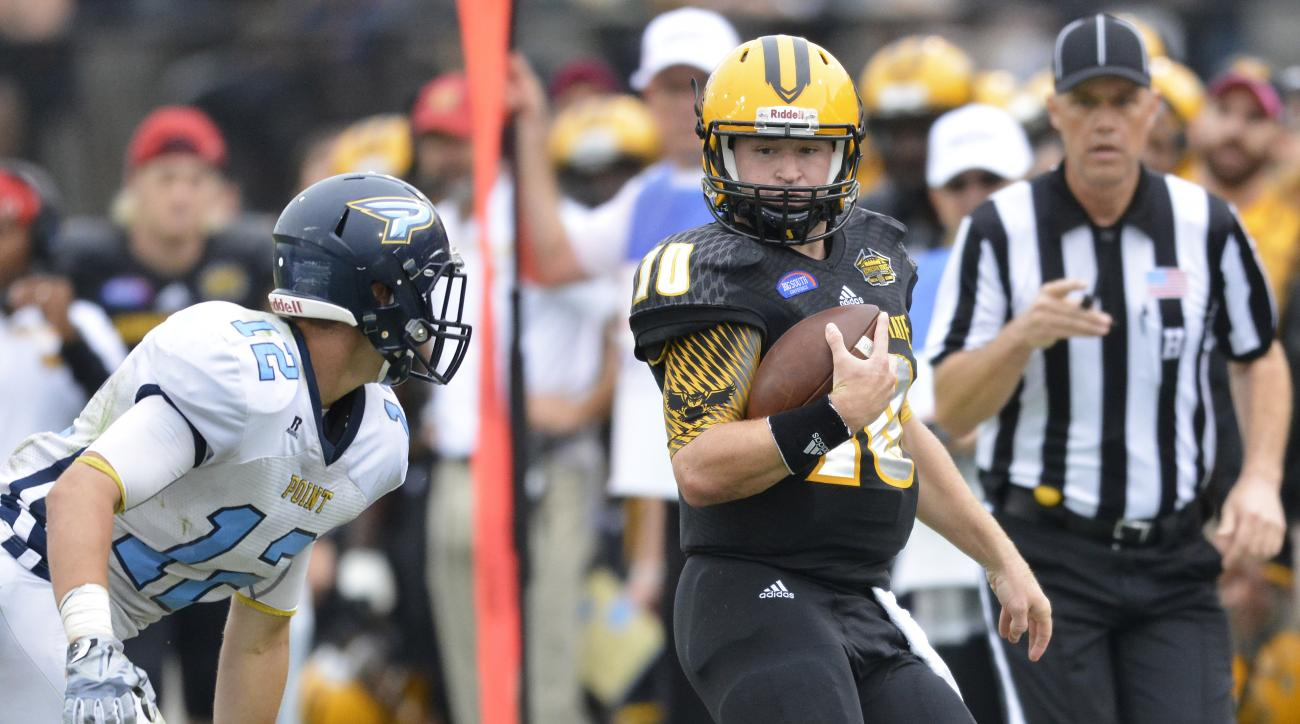 Kennesaw State quarterback Trey White (10) runs against Point linebacker Luke Lynch (12) during the first half of an NCAA college football game, Saturday, Oct. 10, 2015, in Kennesaw, Ga. (AP Photo/Lisa Marie Pane)