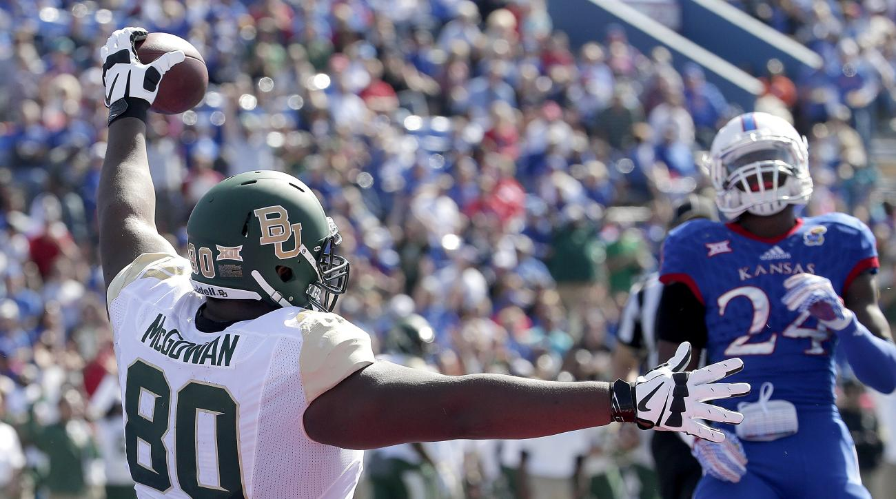 Baylor tight end LaQuan McGowan (80) celebrates after catching a short pass and running into the end zone to score a touchdown during the first half of an NCAA college football game against Kansas, Saturday, Oct. 10, 2015, in Lawrence, Kan. (AP Photo/Char