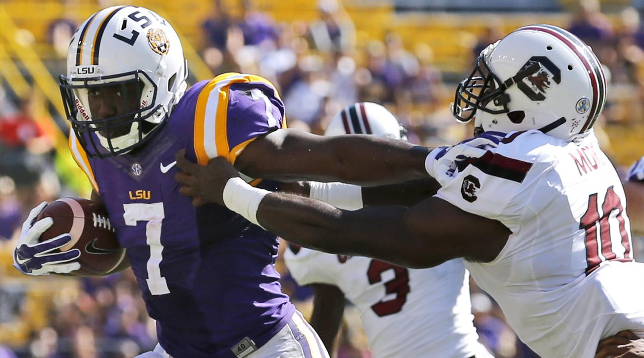 LSU running back Leonard Fournette (7) stiff arms South Carolina linebacker Skai Moore (10) during the first half of an NCAA college football game in Baton Rouge, La., Saturday, Oct. 10, 2015. (AP Photo/Jonathan Bachman)