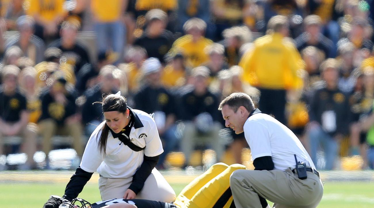 Iowa trainers attend to defensive lineman Drew Ott after he was injured during the second half of an NCAA college football game against Illinois, Saturday, Oct. 10, 2015, in Iowa City, Iowa. (AP Photo/Justin Hayworth)