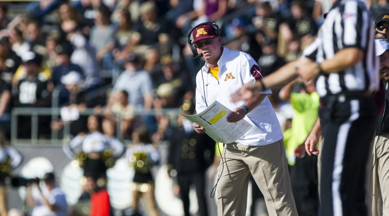 Minnesota head coach Jerry Kill steps onto the field to check the scoreboard during the first half of an NCAA college football game against Purdue, Saturday, Oct. 10, 2015, in West Lafayette, Ind. (AP Photo/Doug McSchooler)