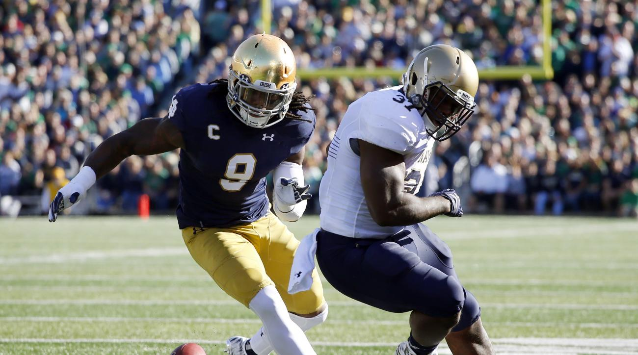 Navy fullback Chris Swain (37) fumbles the ball as Notre Dame linebacker Jaylon Smith (9) goes after it during the first half of an NCAA college football game, Saturday, Oct. 10, 2015, in South Bend, Ind. (AP Photo/Jeff Haynes)