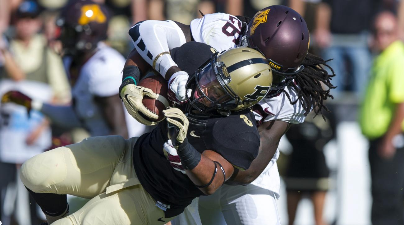 Minnesota linebacker De'Vondre Campbell (26) hits Purdue running back Markell Jones (8) to stop the run during the first half of an NCAA college football game, Saturday, Oct. 10, 2015, in West Lafayette, Ind. (AP Photo/Doug McSchooler)