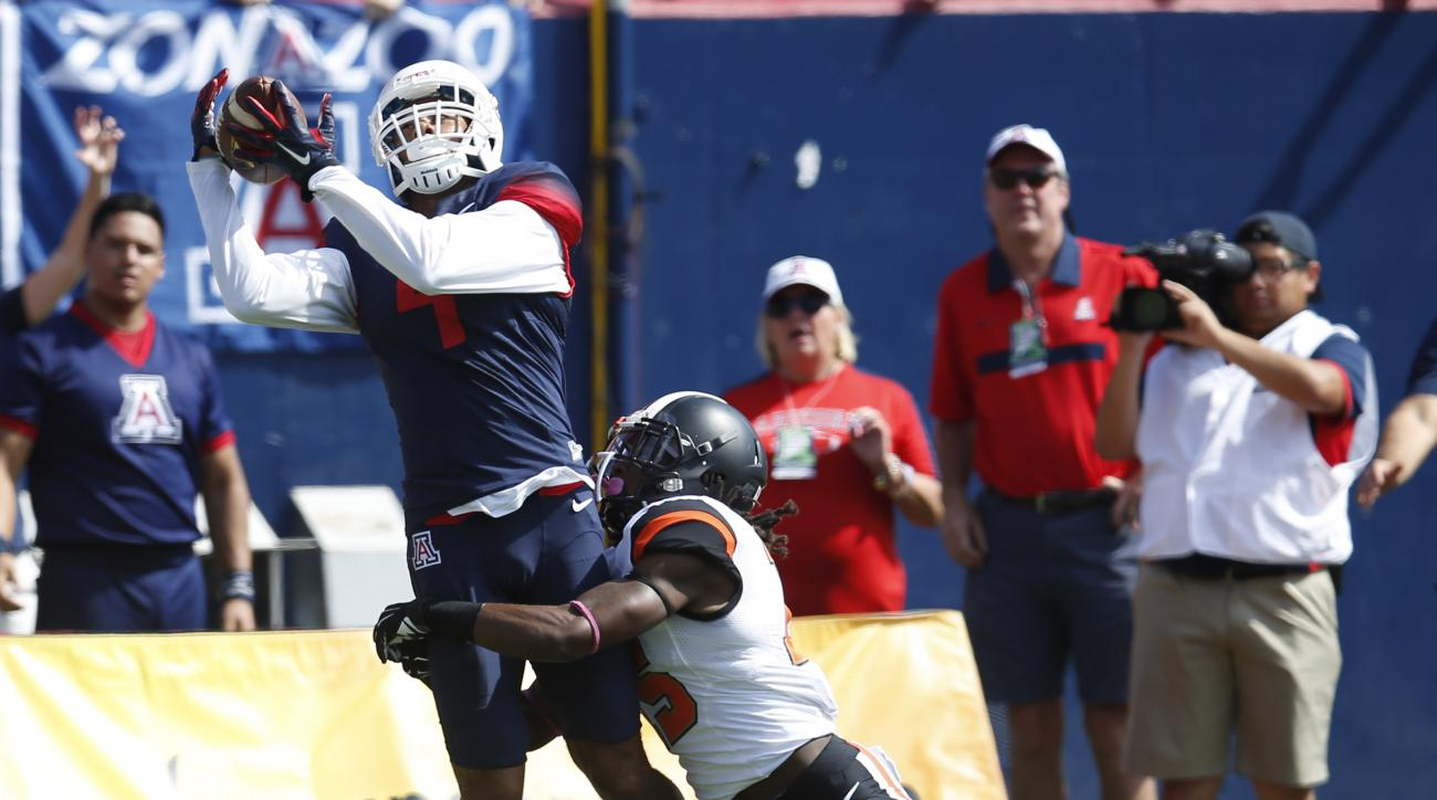 Arizona wide receiver David Richards (4) makes the catch over Oregon State cornerback Larry Scott during the first half of an NCAA college football game, Saturday, Oct. 10, 2015, in Tucson, Ariz. (AP Photo/Rick Scuteri)