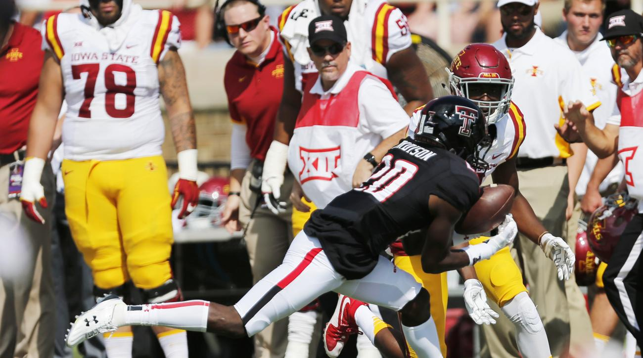 Texas Tech's Tevin Madison intercepts a pass intended for Iowa State's D'Vario Montgomery during an NCAA college football game, Saturday, Oct. 10, 2015, in Lubbock, Texas. (Mark Rogers/Lubbock Avalanche-Journal via AP)