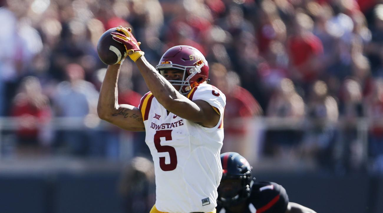 Iowa State's Allen Lazard makes a catch while defended by Texas Tech's Nigel Bethel II  during an NCAA college football game, Saturday, Oct. 10, 2015, in Lubbock, Texas. (Mark Rogers/Lubbock Avalanche-Journal via AP)