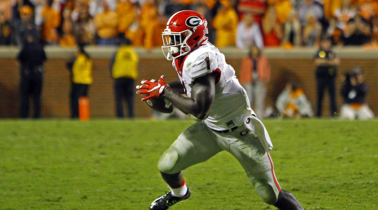 Georgia running back Sony Michel (1) runs for yardage during the second half of an NCAA college football game against Tennessee Saturday, Oct. 10, 2015, in Knoxville, Tenn. Tennessee won 38-31. (AP Photo/Wade Payne)