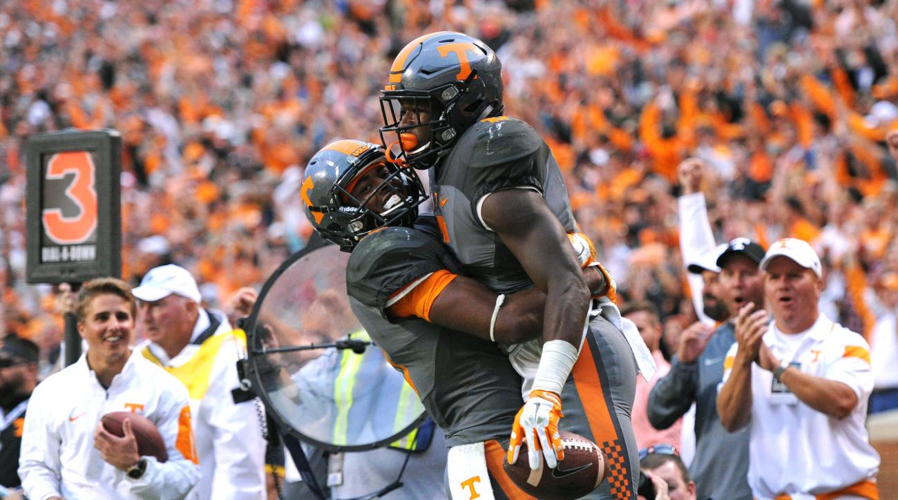 Tennessee wide receiver Jauan Jennings (15), left, celebrates with running back Alvin Kamara (6) after Kamara scored a touchdown against Georgia during the second half of an NCAA college football game, in Knoxville, Tenn. on Saturday, Oct. 10, 2015. (Adam