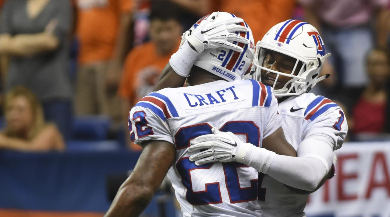 Louisiana Tech running back Jarred Craft is congratulated by teammate Carlos Henderson after scoring a touchdown during the first half of an NCAA college football game against UTSA, Saturday, Oct. 10, 2015, in San Antonio. (Billy Calzada/The San Antonio E