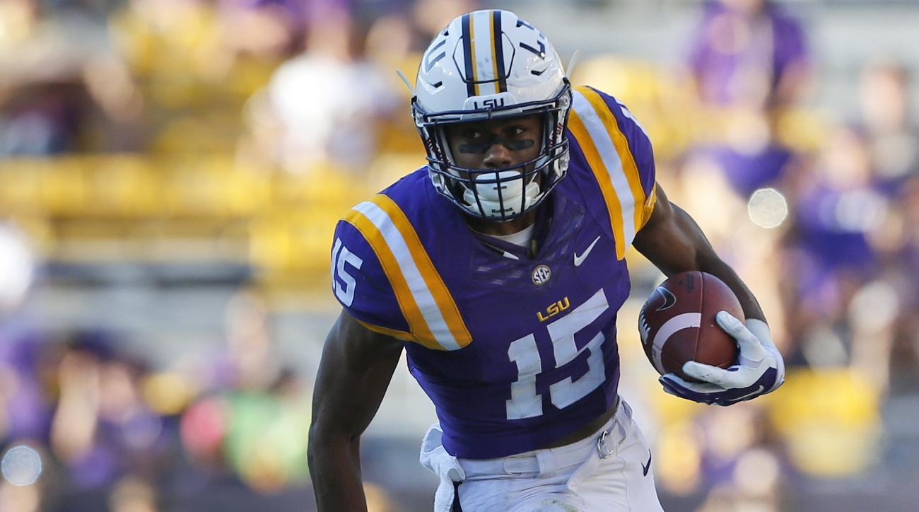 LSU wide receiver Malachi Dupre (15) runs past South Carolina safety Isaiah Johnson (21) after a catch during the second half of an NCAA college football game in Baton Rouge, La., Saturday, Oct. 10, 2015. LSU won 45-24. (AP Photo/Jonathan Bachman)