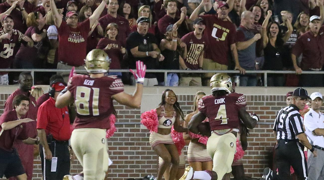 Florida State's Dalvin Cook scores against Miami in the first quarter of an NCAA college football game, Saturday, Oct. 10, 2015 in Tallahassee, Fla. (AP Photo/Steve Cannon)