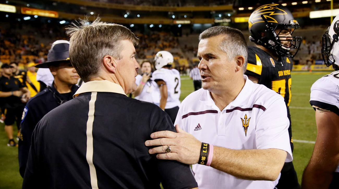 Arizona State head coach Todd Graham, right, greets Colorado head coach Mike MacIntyre after an NCAA college football game, Saturday, Oct. 10, 2015, in Tempe, Ariz. Arizona State won 48-23. (AP Photo/Matt York)